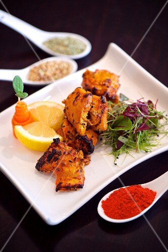 Marinated, grilled chicken with spices and lemons