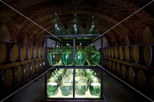 Bottles and barrels of vinegar in a cellar