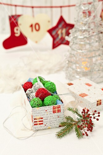 Christmas truffles with white, green and red sugar sprinkled
