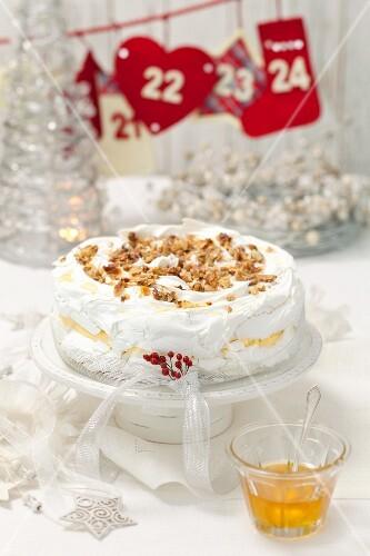 Pavlova with vanilla cream and nuts
