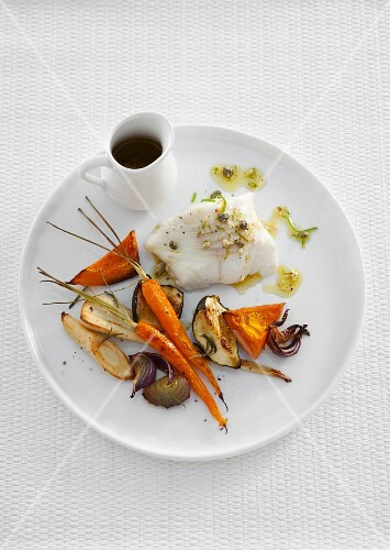 Steamed cod with a horseradish sauce and oven-baked vegetables