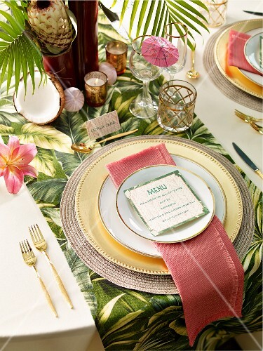 A place setting with a menu on an exotically laid table