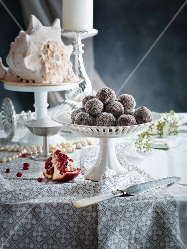 Plum pralines with sugar on a table decorated for Christmas