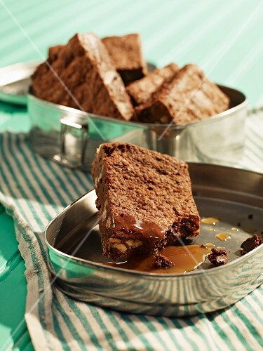 Brownies with butterscotch sauce in a tin for a picnic