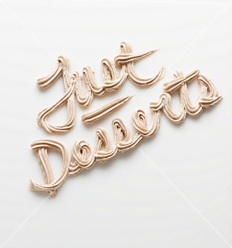 The phrase 'Just Desserts' written in frosting