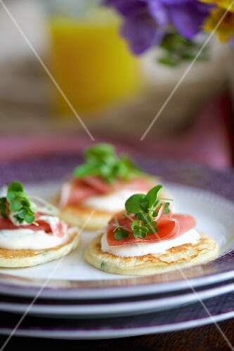Blinis with mustard sour cream, Serrano ham and watercress