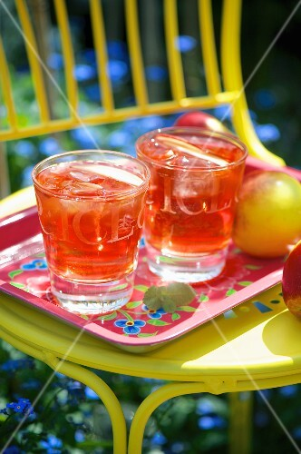 Two refreshing fruit cocktails at a summer party