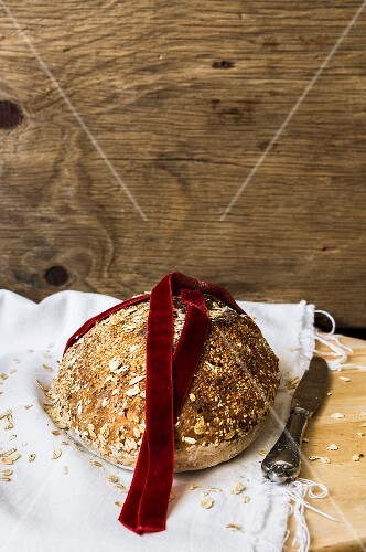 Wholemeal bread with a red velvet ribbon