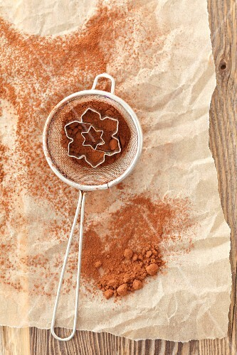 Cocoa powder in a sieve with cutters