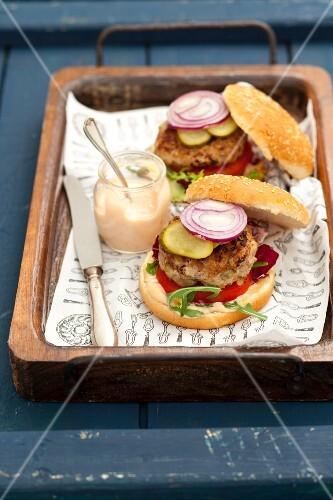 Pork burgers with mayonnaise on a tray