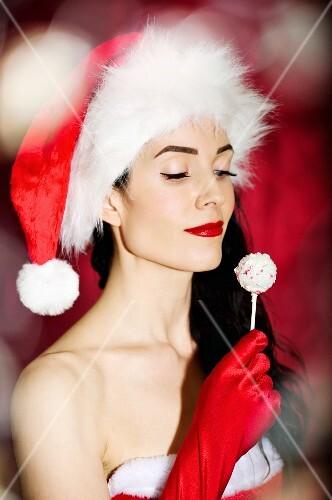 A sexy Christmas lady holding a cake pop