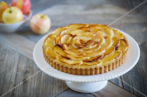 An apple tart on a cake stand