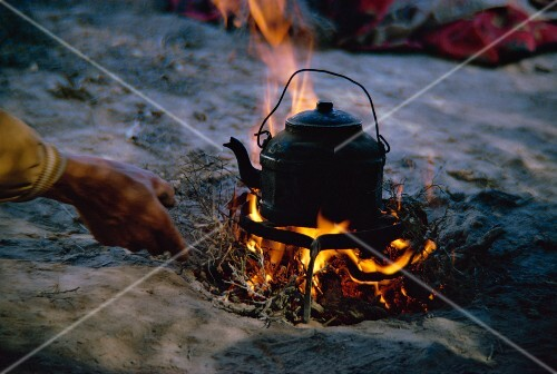 A kettle over an open fire in Qashqai camp, Iran, Middle East