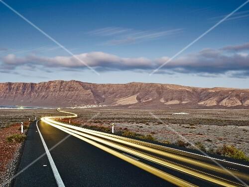 Light tracks on the road to Famara on Lanzarote (Spain)