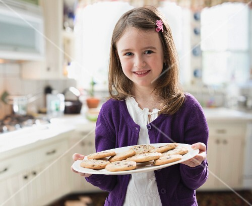 A little girl with homemade biscuits