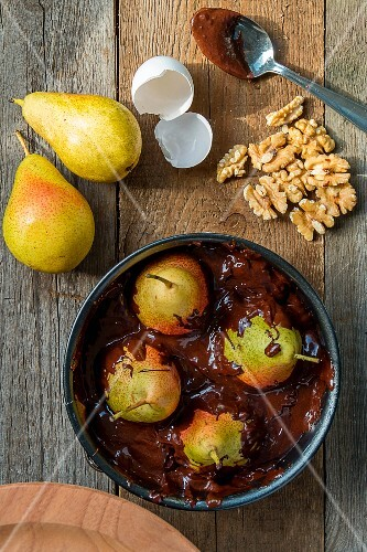 Chocolate cake with pears and walnuts (unbaked)