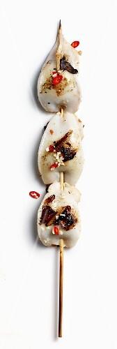 Stuffed squid on a skewer