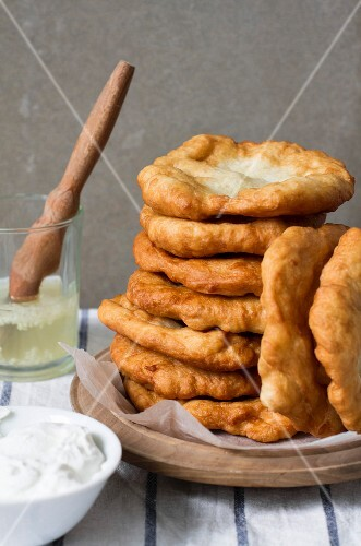 A stack of langos with sour cream