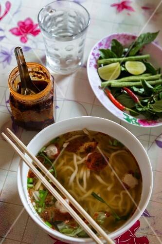 Noodle soup, chilli oil and vegetables (Vientiane, Laos)