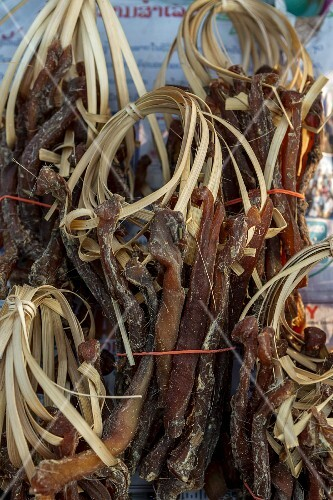 Bundles of dried pork at a market (Vientiane, Laos)
