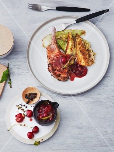 Iberico pork chops with pointed cabbage and a sour cherry sauce