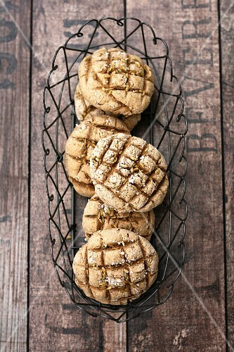 Rye bread rolls in a wire basket