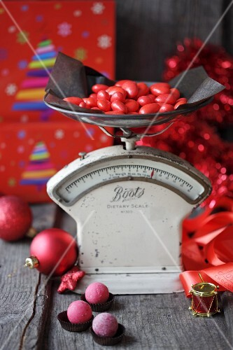 Christmas sweets on a pair of old scales