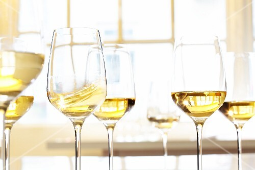Glass of white wine in front of a window