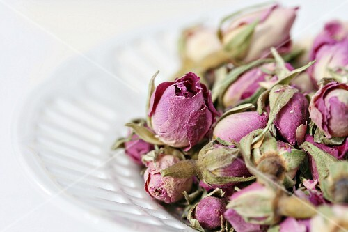 Dried rosebuds in white china bowl
