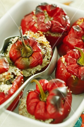Peppers filled with rice and dates sprinkled with sesame seeds