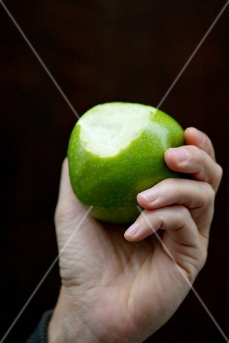 Hand Holding a Bitten Apple; White Background