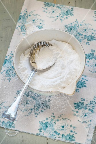 Icing sugar in a antique bowl with a spoon
