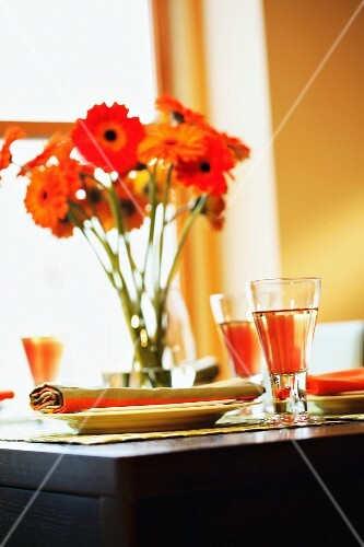 A summery laid table with gerberas and Californian wine