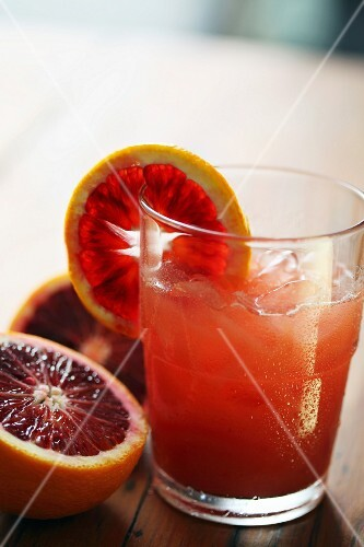 Blood orange juice with ice cubes