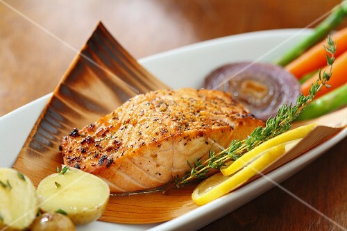 Salmon in maple syrup on a thin wooden sheet