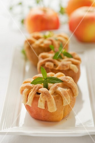 Baked apple topped with pastry strips