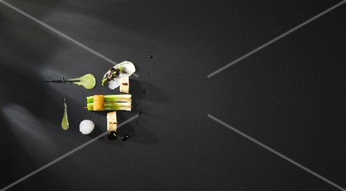 Variations of black-feathered chicken with green bananas, leek emulsion, peanut puree and eucalyptus foam (flavour pairing)