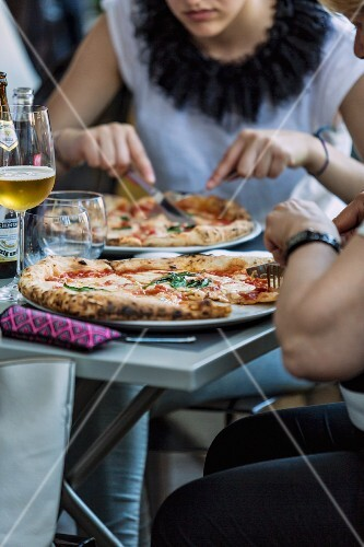 Guests eating pizza in a restaurant