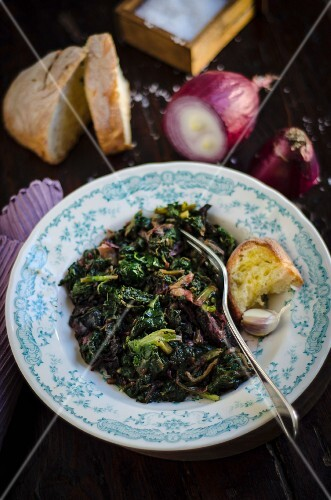 Steamed mixed vegetables consisting of spinach, chard and Chinese cabbage with onions