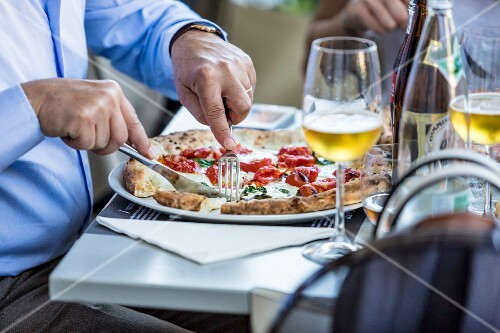 People enjoying pizza and beer