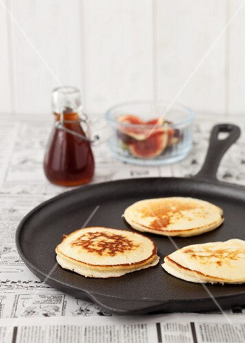 Three American pancakes in a pan ready to be served
