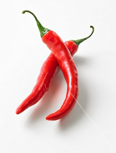 Two fresh red chilli peppers