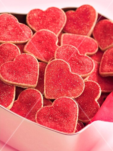 Red heart-shaped biscuits in a biscuit tin