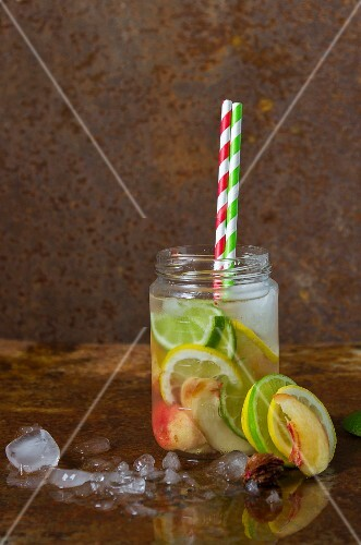 Homemade lemonade in a screw-top jar with straws