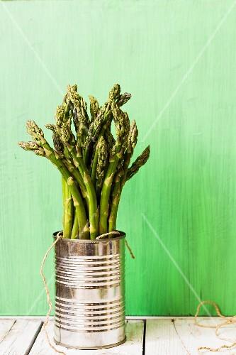 Green asparagus in a tin can