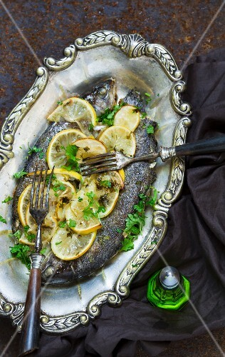 Fried trouts with lemons and parsley