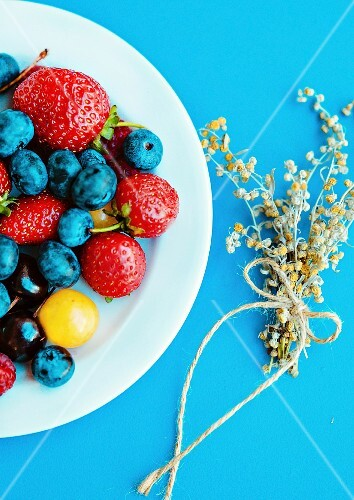 Summer berries on a white plate