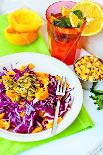 Red cabbage salad with oranges and pumpkin seeds