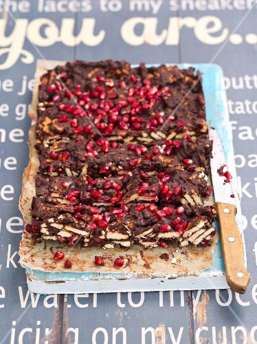 Chocolate cake made with biscuits and pomegranate seeds