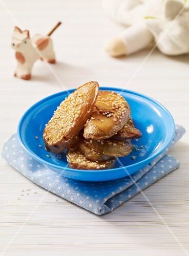 Roast potatoes with sesame seeds as baby food